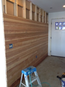 Salvaged Flooring Resurrected as a Wall